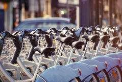 Photo of bicycles on parking places. Photo of beautiful blue retro bicycles standing on the parking places Royalty Free Stock Photography