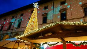 Photo of big christmas tree in the main square of Piazza Grande of Arezzo, Tuscany stock photo
