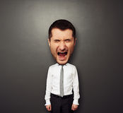 Photo of bighead screaming man. Over dark background Royalty Free Stock Photography