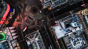 Photo of Bird`s Eye View Flying Over Piccadilly Circus, London, England. Aerial View Photo of Bird`s Eye View Flying Over Piccadilly Circus and City Streets at Royalty Free Stock Photo