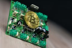 Photo of Bitcoin or Bitcoin cash on electronic circuit, computer part royalty free stock photography