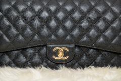 Photo of black Chanel handbag brand Editorial on white background. Lawrence Township New Jersey, March 1, 2019:Photo of black Chanel handbag brand Editorial on royalty free stock photo