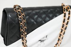 Photo of black Chanel handbag brand Editorial on white background. Philadelphia, Pennsylvania, USA, August 10, 2018: Photo of black Chanel handbag brand royalty free stock photos