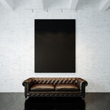 Photo of black empty canvas on the painted brick Stock Image