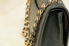 Photo of black handbag on the table.  royalty free stock images