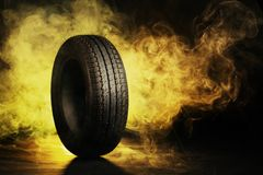 Photo of black smoked burning tire Stock Photography