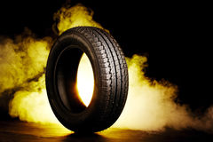 Photo of black smoked burning tire Royalty Free Stock Photography