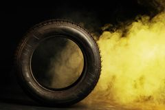 Photo of black smoked burning tire Royalty Free Stock Image
