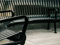 Photo of Black Steel Armchair and Bench Stock Images