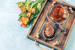 Photo of black tea, cake with cream Stock Image