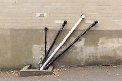 A photo of black and white angular water pipes on a beige brickw Royalty Free Stock Photos