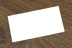 Photo of blank business cards on a wooden background. Stock Photo