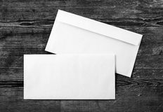 Photo of blank envelopes. Photo of two blank envelopes on a dark wooden background. Back and front. Template for design portfolios. Mock-up for your design. Top stock photos