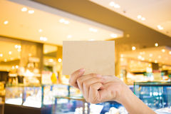 Photo blank. Hand hold blank business card in the shopping mall. Stock Photography