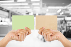 Photo blank. Hand hold blank business card in the shopping mall. Stock Photo