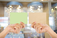 Photo blank. Hand hold blank business card in the shopping mall. Stock Images