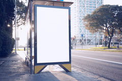 Photo blank lightbox on bus stop in the modern city. Horizontal mockup, sunlight Stock Image