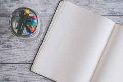 Photo of Blank Note Book Near Clear Jar Royalty Free Stock Photos