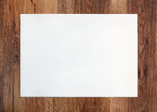 Photo of the blank paper on wooden Royalty Free Stock Photo