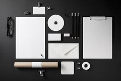 Blank corporate stationery. Photo of blank stationery set on black background. Corporate identity mock up for placing your design. Top view Royalty Free Stock Images
