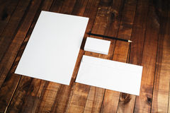 Photo of blank stationery set. On vintage wooden table background. Blank ID template. Mock-up for branding identity. Letterhead, business cards, envelope and Stock Image