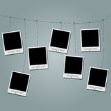 Photo blanks on a rope on gray Royalty Free Stock Photography