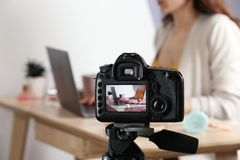 Photo of blogger at workplace on camera screen, closeup. With space for text royalty free stock photography