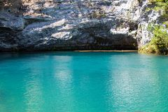 Photo of blue lake and cavern Stock Photography