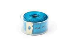 Photo blue measuring tape in a box Royalty Free Stock Photo