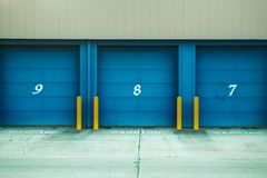 Photo of Blue Shutter Door Stock Photo