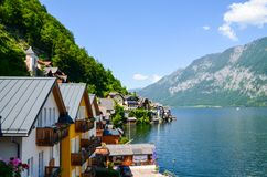 Photo Of Body of Water Beside Houses Stock Photo