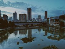 Photo of Body of Water Near Concrete Buildings royalty free stock images