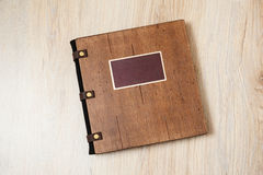 Photo book in a brown wooden cover Royalty Free Stock Photos