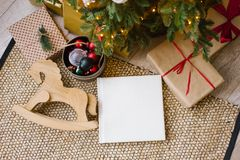 Free Photo Book In White Leather Cover, Wedding Or Family Photo Album Under The Christmas Tree Surrounded Royalty Free Stock Image - 160584496