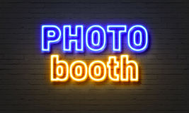 Photo booth neon sign on brick wall background. Royalty Free Stock Images