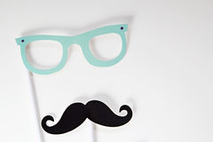 Photo booth props isolated on a white background. Paper photo booth props on sticks isolated on white background includes glasses and mustache Stock Photography