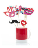 Photo Booth Props in a Red Mug royalty free stock photo