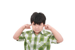 Photo of a boy closing his ears with his fingers. Royalty Free Stock Photos