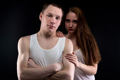 Photo of boy and helpless girl Royalty Free Stock Image