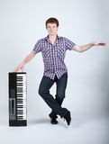Photo of boy with piano royalty free stock photo