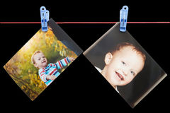 Photo boy on a rope with clothespin on a black background Stock Photo