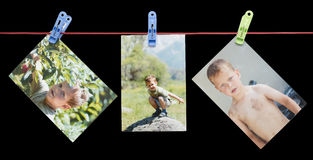 Photo boy on a rope with clothespin on a black background Royalty Free Stock Photos