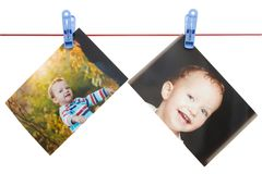 Photo boy on a rope with a clothespin on a white background Stock Images
