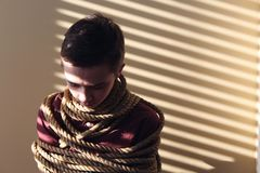 Photo of a Boy Tied With Ropes Royalty Free Stock Image