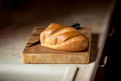 Photo of bread and knife on wooden desk Royalty Free Stock Image