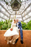 Photo of bride and groom at tropical orangery Royalty Free Stock Images