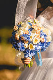 Photo of bride holding wedding bouquet in hand Royalty Free Stock Images