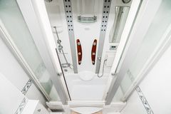 The photo of a bright white shower cabin stock photos