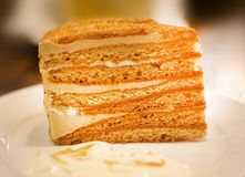 Photo of a brightly colored honey cake. Photo of a close-up of a delicious brightly colored honey cake in a cafe stock photos