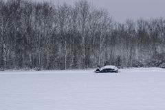 Car Breakdown in Snowy Road / Landscape in French Countryside during Winter stock photo